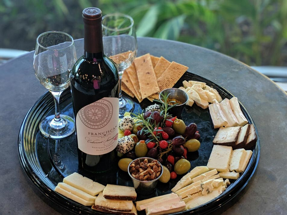 Wine and cheese on a tray